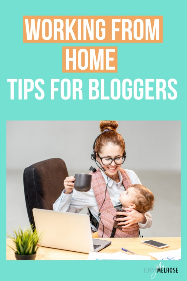 Mom with baby in a carrier drinking coffee and working from home