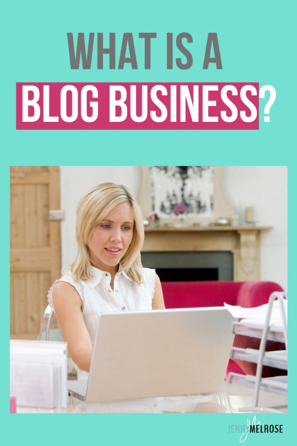 Woman sitting at desk with a laptop working on her blog business